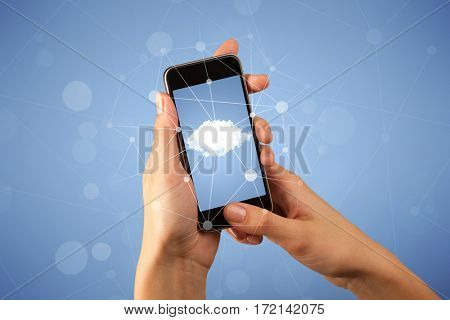 Female fingers touching smartphone with cloud concept