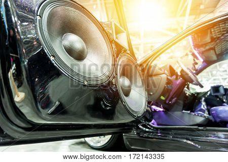 Speakers in a sport car in the sunlight