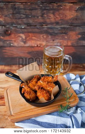 A Plate Of Fresh, Hot, Crispy Fried Chicken With Red Sause On A Blue Plaid Towel On A Wood Table. Sn
