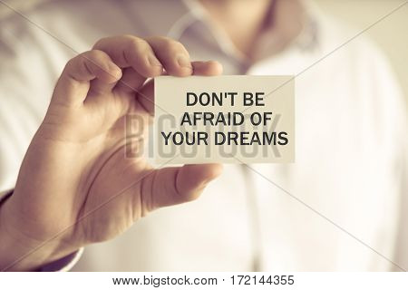 Businessman Holding Dont Be Afraid Of Your Dreams Message Card