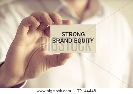 Businessman Holding Strong Brand Equity Message Card