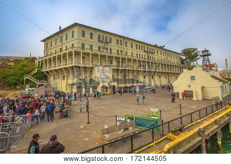 San Francisco, United States - August 14, 2016: Panorama of Historic landmark of Alcatraz prison with officer's club, water tower, guardhouse, guard tower, theater, ranger station, bookstore and dock.