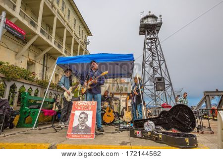 San Francisco, California, United States - August 14, 2016: concert at Alcatraz penitentiary sally port of William G. Baker a former prisoner of Alcatraz, number 1259. Writer of a book about prison.
