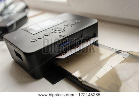 Printer Print Of Photos On A Table