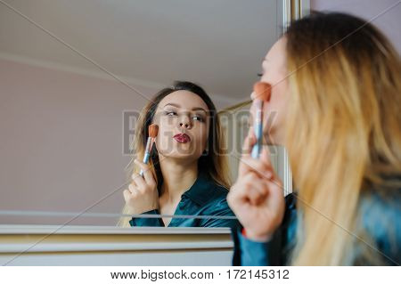 Applying Dry Cosmetic Tonal Foundation On The Face Using Makeup Brush.