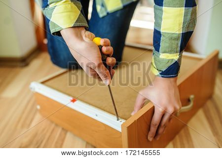 Woman's Hands Working With A Screwdriver