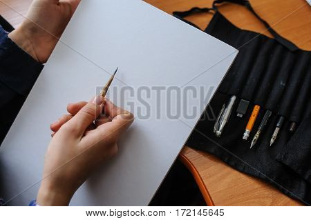 Top View Of Female Hands With Pencil