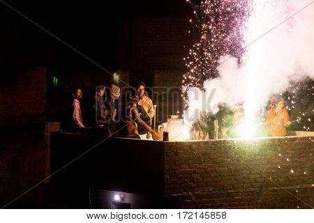 Jaipur, India - 14th Jan 2017 : People enjoying fireworks on a rooftop during makar sankranti or diwali.