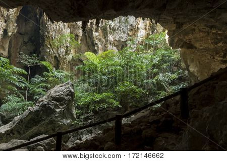 Sunlight Through A Cave Hole In Thailand.