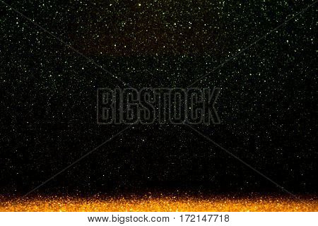 Abstract background filled with shiny gold and green glitter