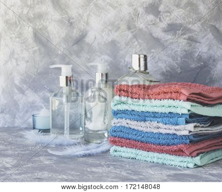 stack of towels for bathroom bottle on a white marble background, space for text, selective focus