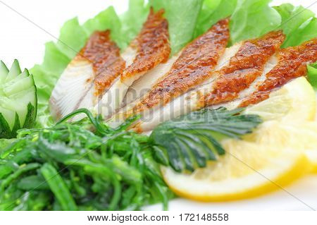 Sashimi of eel, vegetables, salad, cucumber, eel on a white background