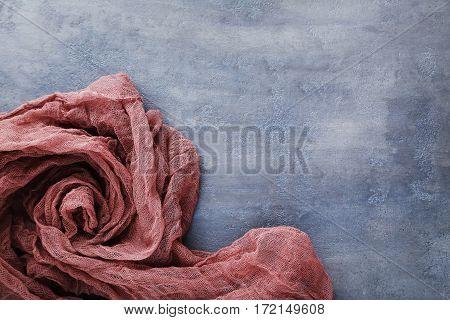 Burgundy Gauze Fabric On Grey Wooden Table