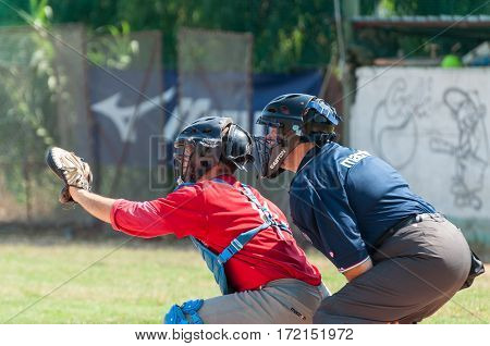 Rome Italy - July 11 2010: A catcher and the referee during an inning of a game in a local cup