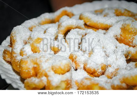 A funnel cake with powdered sugar on it