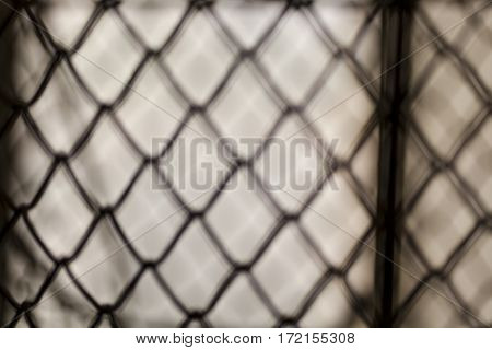 Blurred metal wire net on window vague abstract dissolved
