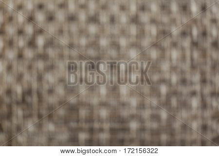 Blurred abstract monochrome yellowish criss cross texture background