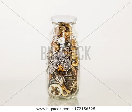 a bottle of shiny apparel fasteners - buttons
