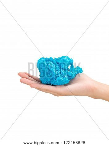 Woman hand holding a blue color plastic bag in ball composition Isolated on white background.