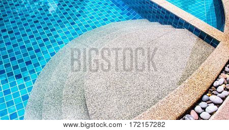 Close up step stones in the swimming pool