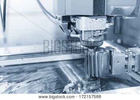 Abstract scene of close-up of the wire - EDM CNC machine while cutting the sample work pieces in light blue tone