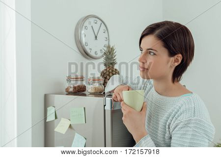 Woman Having A Coffee Break At Home