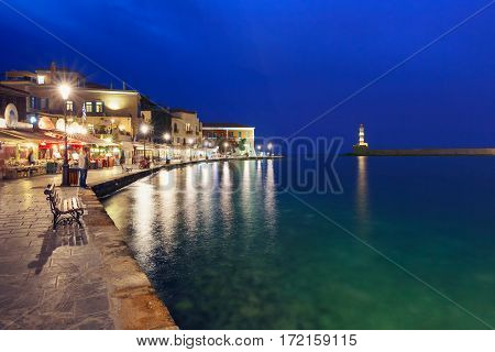 Picturesque view of old harbour with Lighthouse of Chania during twilight blue hour, Crete, Greece