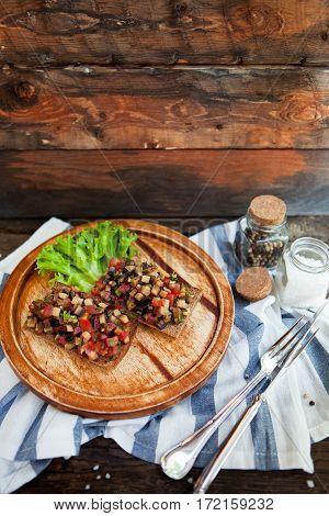 Italian Tomato Bruschetta With Chopped Vegetables, Herbs And Oil On Grilled Or Toasted Crusty Bread