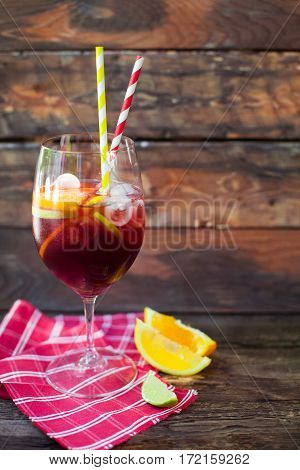 Sangria and components wearing spectacles on a wooden background