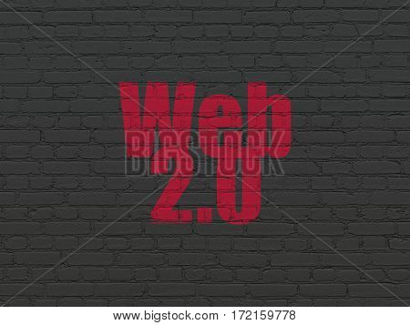Web development concept: Painted red text Web 2.0 on Black Brick wall background