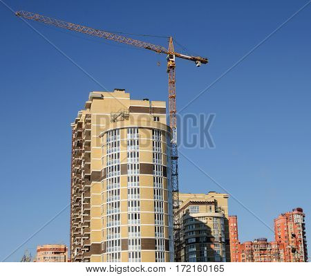 Completion of construction of high-rise buildings on the background of the urban area.