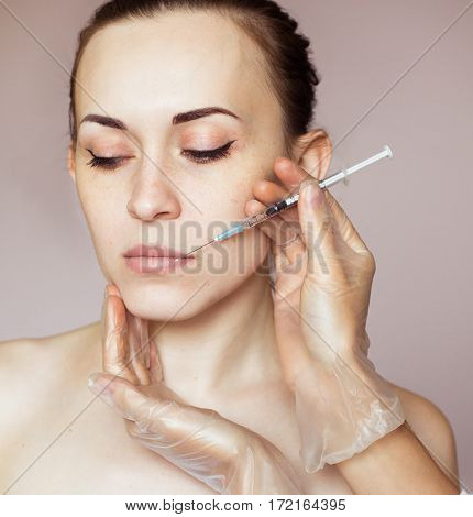Young Woman Receiving Cosmetic Injection