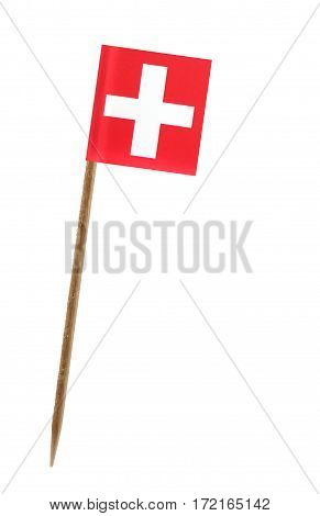 Tooth pick wit a small paper flag of Switzerland