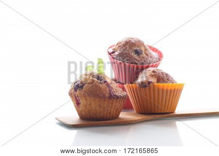 sweet muffins with berries inside on a white background