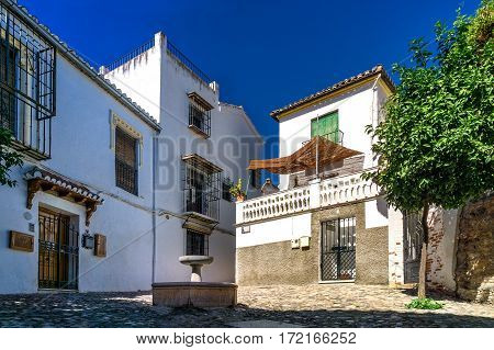 Andalusian backyard. architecture photo: backyard with fountain in the old Arabian district Albaicin in Grenada (Andalusia, Spain).