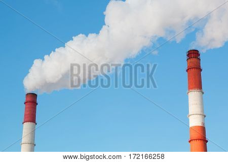 Industrial, ecology and environmental pollution. The smoke from the chimney of the industrial plant.