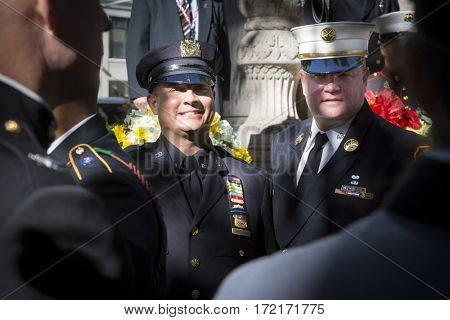 NEW YORK - 11 NOV 2016: 2016 Grand Marshals NYPD Det. Nelson Vergara and FDNY Battalion Chief Joseph Duggan Jr. at the Eternal Light Monument wreath laying ceremony-Madison Square Park, Veterans Day.