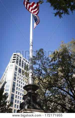 NEW YORK - 11 NOV 2016: American Flag flies from the Eternal Light Monument at wreath laying ceremony in Madison Square Park before the annual Americas Parade up 5th Ave on Veterans Day, Manhattan.