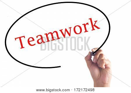 Hand writing of Teamwork on transparent board