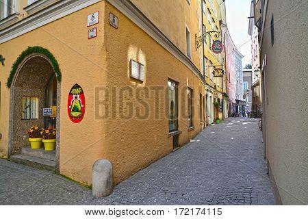 Salzburg austria - april 25: snapshot of a narrow street in the old city center of salzburg austria. shot taken on april 25th 2015