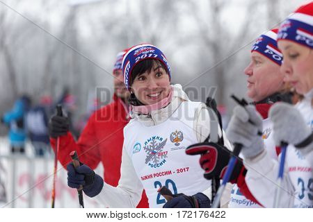 ST. PETERSBURG, RUSSIA - FEBRUARY 11, 2017: People preparing to the start of the mass ski race Ski Track of Russia. The race is held annually since 1982