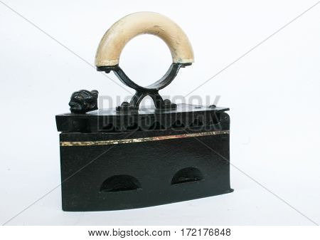Old coal iron over the white background