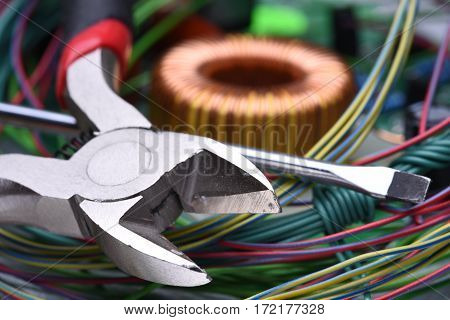 Electronic components and tool close up on metal background