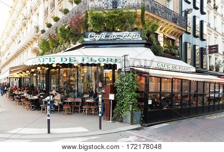 Paris France-February 15 201 :The cafe De Flore located at the corner of boulevard Saint Germain and rue Saint Benoit . It was once home to intellectual stars from Hemingway to Pablo Picasso.