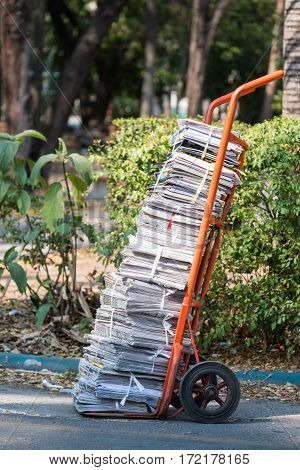 Old magazines tied together on the cart.