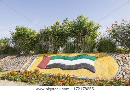 UAE national flag monument in a roundabout in Liwa Oasis. Emirate of Abu Dhabi United Arab Emirates Middle East