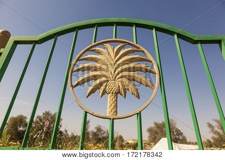 Palm tree figure in a fence in the desert town Mezairaa. Emirate of Abu Dhabi United Arab Emirates Middle East