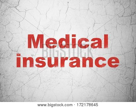 Insurance concept: Red Medical Insurance on textured concrete wall background
