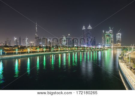 Dubai Water Canal and the downtown skyline illuminated at night. United Arab Emirates Middle East