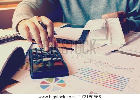 Calculation With Receipt Bill And Man Calculate About Cost At Home.